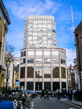 economist: LONDON, ENGLAND, UK - MARCH 04, 2009: The Economist Building designed in 1962 by Alison and Peter Smithson is a masterpiece of new brutalist architecture also featured in the opening scene of Michelangelo Antonioni movie Blow Up (HDR) Editorial