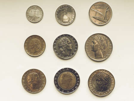 replaced: Vintage looking Old Italian liras coins now withdrawn and replaced by Euro Stock Photo