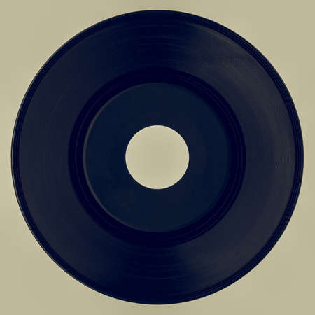 rpm: Vintage looking Vinyl record with black label isolated over white background