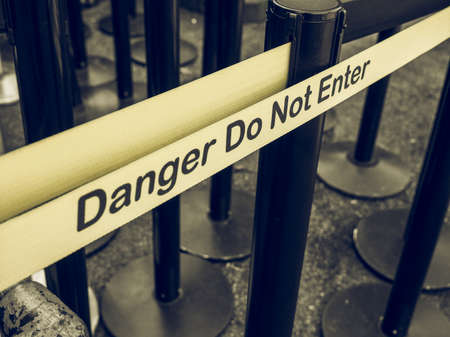 do not enter: Vintage looking Yellow band fence danger do not enter warning sign Stock Photo