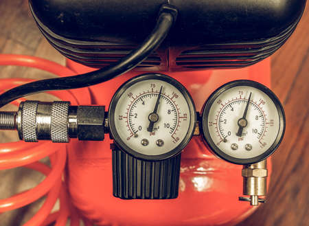 air pressure: Vintage looking Detail of air compressor with manometer to measure air pressure