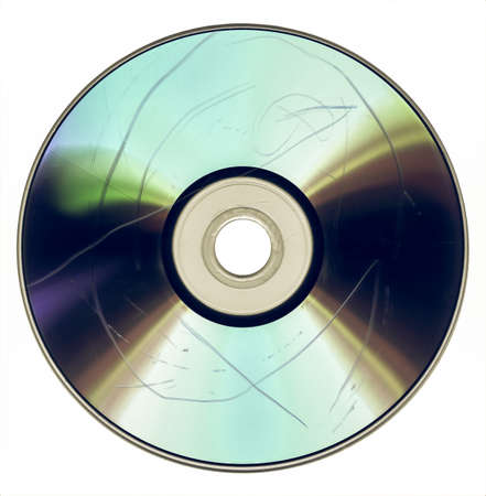 data loss: Vintage looking Data loss due to dust and scratch on badly damaged CD DVD optical media Stock Photo