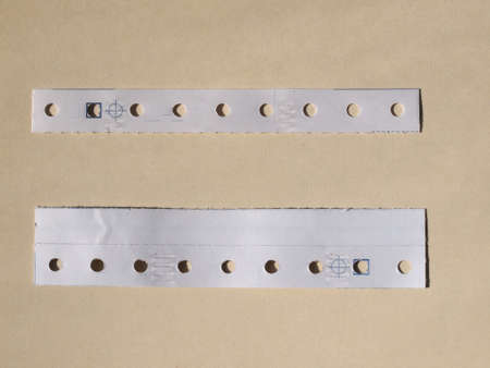 perforated: Perforated paper strips used in tabulated paper for computer prints
