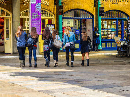 occupied: Girls visiting the shopping centre in newly redeveloped Docklands area once occupied by docks (HDR)