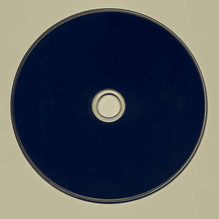 Vintage looking Black CD or DVD isolated over white background