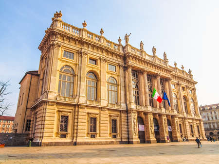 TURIN, ITALY - MARCH 11, 2014: Tourists in front of Palazzo Madama (Royal palace) in Piazza Castello (HDR)