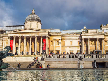 trafalgar: LONDON, ENGLAND, UK - OCTOBER 23: Tourist visiting the world famous Trafalgar Square on October 23, 2013 in London, England, UK (HDR)