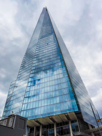 shard: LONDON, UK - JUNE 10, 2015: The Shard skyscraper designed by Italian architect Renzo Piano is the highest building in town (HDR)
