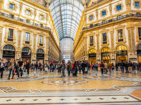 MILAN, ITALY - MARCH 28, 2015: Tourists visiting the Galleria Vittorio Emanuele II recently restored for the Expo Milano 2015 international exhibition (HDR) Editorial