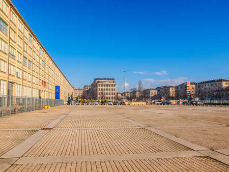 TURIN, ITALY - JANUARY 24, 2014: The Fiat Lingotto car factory designed by Trucco in 1916 was the largest car factory at the time and still houses the Fiat directional centre and an exhibition complex (HDR)
