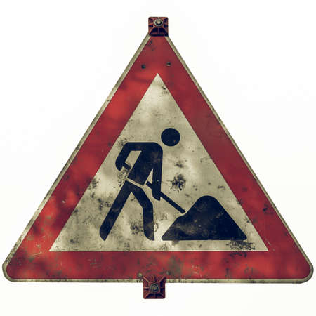 Vintage looking Road works sign for construction works in street - in German (Deutsch) - isolated over white background