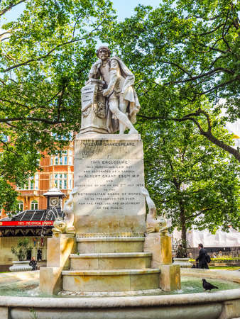 LONDON, UK - JUNE 10, 2015: Statue of William Shakespeare built in 1874 in Leicester Square (HDR)