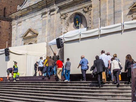 queueing: TURIN, ITALY - APRIL 22, 2015: People queueing in front of Turin cathedral to visit the Holy Shroud of Turin (HDR)