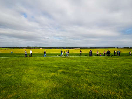 druid: WILTSHIRE, ENGLAND, UK - CIRCA SEPTEMBER 2016: HDR Tourists visiting ruins of Stonehenge prehistoric megalithic stone monument Editorial