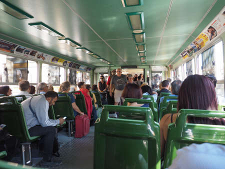 waterbus: VENICE, ITALY - CIRCA SEPTEMBER 2016: Travellers on a vaporetto (meaning waterbus) public transport Editorial