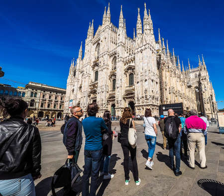 queueing: MILAN, ITALY - CIRCA APRIL 2016: Tourists queueing to visit Duomo di Milano (meaning Milan Cathedral) gothic church (HDR)