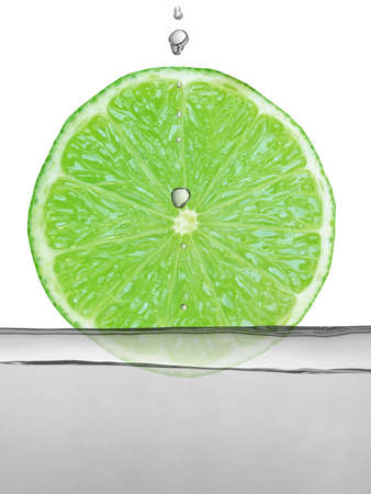 alcoholic drink: Alcoholic cocktail drink with green lime slice and droplets