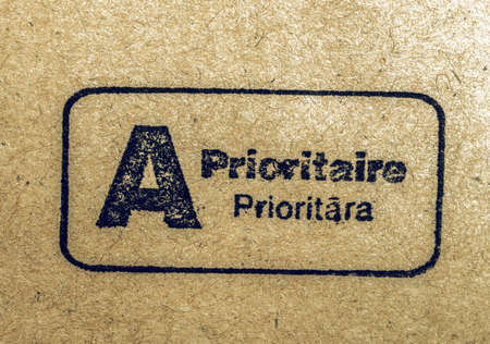 postmark: Vintage looking International priority mail postmark on a letter envelope written in French and Latvian Stock Photo