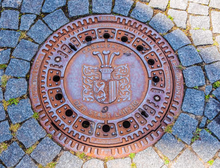 LEIPZIG, GERMANY - JUNE 12, 2014: Detail of a manhole in the street (HDR)