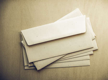 sobres para carta: Vintage looking Letter envelopes for mail postage on wooden table