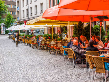 LEIPZIG, GERMANY - JUNE 14, 2014: Tourists in a Biergarten the city centre in summer (HDR)