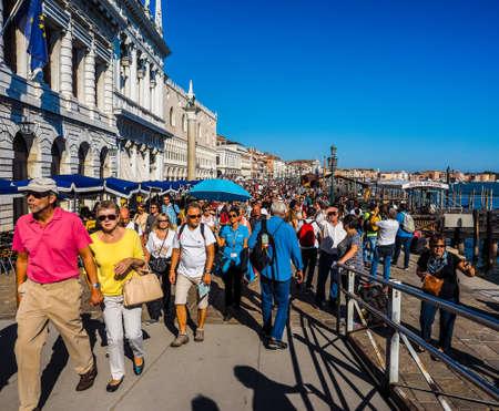 VENICE, ITALY - CIRCA SEPTEMBER 2016: HDR Tourists in Riva degli Schiavoni waterfront promenade at St Mark Basin