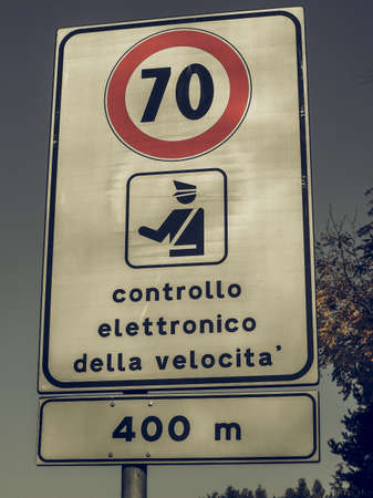 kilometres: Vintage looking Regulatory signs, Maximum speed limit traffic sign with Italian text controllo elettronico della velocita meaning electronic speed check Stock Photo