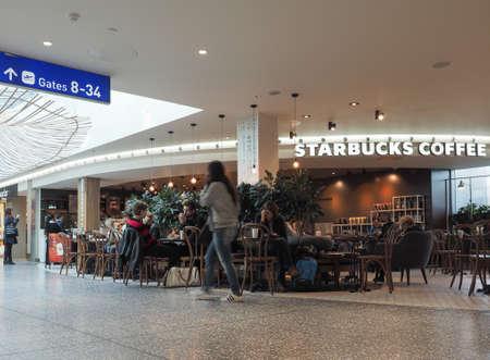 starbucks coffee: BRISTOL, UK - CIRCA OCTOBER 2016: Starbucks Coffee bar at Bristol airport