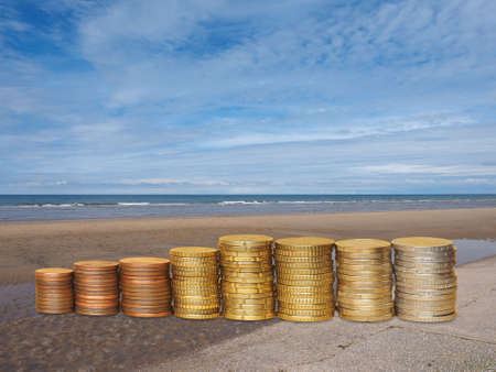 Piles of money on the shore by the sea