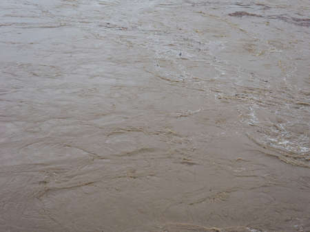 muddy: Brown muddy water surface useful as a background