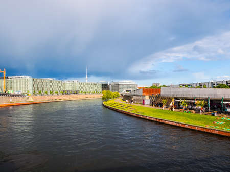 spree: BERLIN, GERMANY - MAY 11, 2014: Tourists on the Spree River shore (HDR)