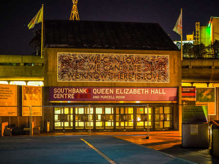 banco mundial: LONDON, UK - SEPTEMBER 27, 2015: Queen Elizabeth Hall iconic masterpiece of the New Brutalism and world class music venue part of the South Bank Centre at night (HDR)