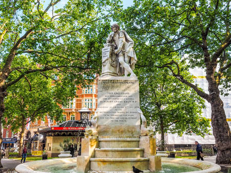 leicester: LONDON, UK - JUNE 10, 2015: Statue of William Shakespeare built in 1874 in Leicester Square (HDR)