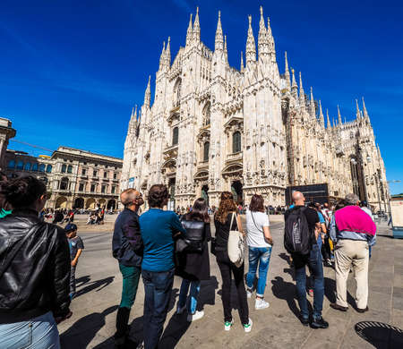 MILAN, ITALY - CIRCA APRIL 2016: Tourists queueing to visit Duomo di Milano (meaning Milan Cathedral) gothic church (HDR)