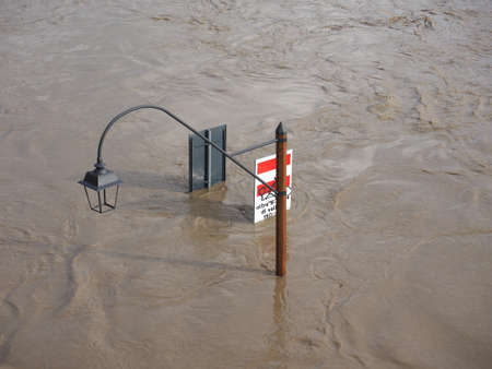 submerged: Street Lamp on Murazzi bank of River Po submerged in water due to flood in city centre in Turin, Italy