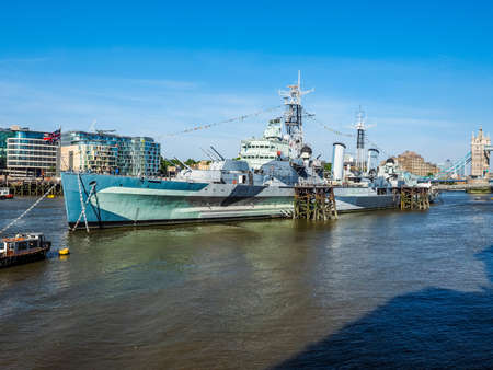 LONDON, UK - JUNE 11, 2015: HMS Belfast ship originally a Royal Navy light cruiser is now permanently moored on the River Thames as a museum ship (HDR)