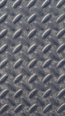 treadplate: Grey steel diamond plate useful as a background - vertical