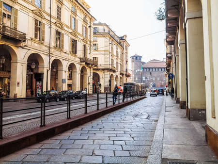 TURIN, ITALY - MARCH 11, 2014: Car traffic in Via Po ancient baroque street (HDR) Editorial