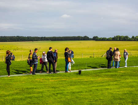 WILTSHIRE, ENGLAND, UK - CIRCA SEPTEMBER 2016: HDR Tourists visiting ruins of Stonehenge prehistoric megalithic stone monument Editorial