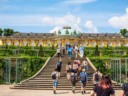 frederick: POTSDAM, GERMANY - CIRCA JUNE 2016: Tourists visiting the Schloss Sanssouci royal summer palace of Frederick the Great King of Prussia (HDR)