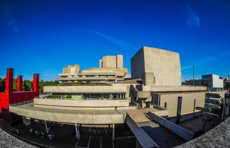 sir: LONDON, UK - SEPTEMBER 28, 2015: The National Theatre designed by Sir Denys Lasdun is a masterpiece of new brutalist architecture seen with fisheye lens (HDR)