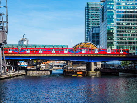 LONDON, UK - JUNE 11, 2015: The DLR meaning Docklands Light Railway links the docks redevelopment area in East London with the city centre (HDR)