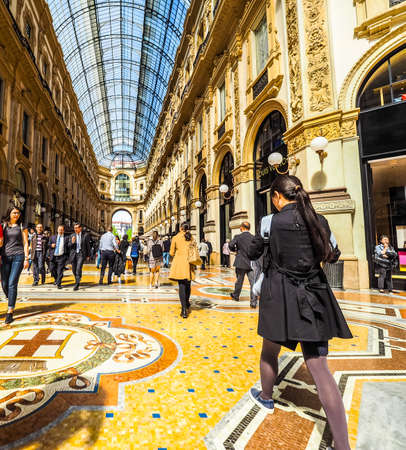 MILAN, ITALY - CIRCA APRIL 2016: Tourists in Galleria Vittorio Emanuele II gallery (HDR) Editorial