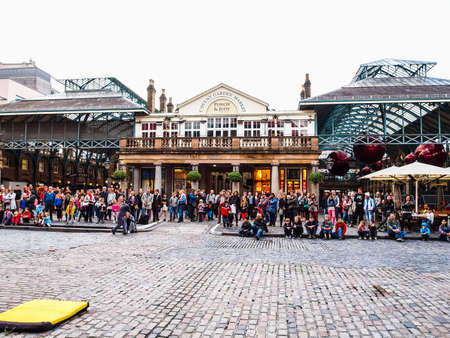 covent: LONDON, ENGLAND, UK - OCTOBER 23: Tourists visiting the world famous Covent Garden on October 23, 2013 in London, England, UK (HDR) Editorial