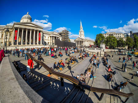 LONDON, UK - SEPTEMBER 27, 2015: Tourists in Trafalgar Square in front of the National Gallery (HDR)