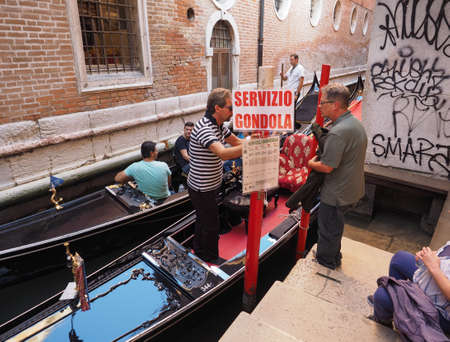 means: VENICE, ITALY - CIRCA SEPTEMBER 2016: Gondola traditional flat bottomed rowing boat in the Venetian lagoon. Servizio gondola means Gondola service