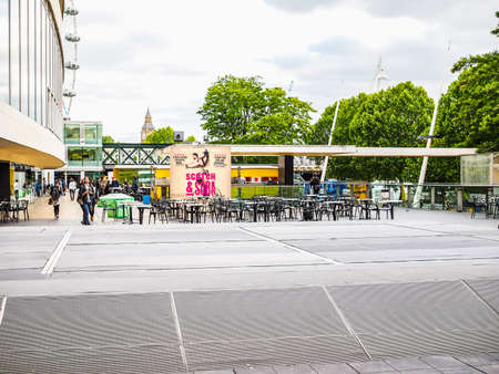 LONDON, UK - JUNE 09, 2015: People walking on the South Bank of Thames River (HDR)