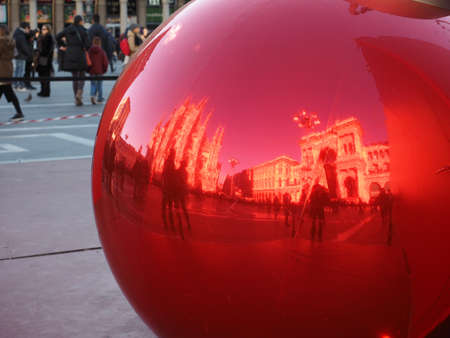 MILAN, ITALY - CIRCA JANUARY 2017: Piazza Duomo (meaning Cathedral Square) reflected on Christmas bauble decoration