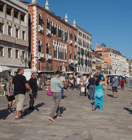st mark: VENICE, ITALY - CIRCA SEPTEMBER 2016: Tourists in Riva degli Schiavoni waterfront promenade at St Mark Basin