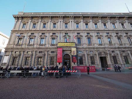 scala: MILAN, ITALY - CIRCA JANUARY 2017: Palazzo Marino 16th century palace is the Milan City Hall in Piazza della Scala (Verita per Giulio Regeni means Truth for Giulio Regeni)